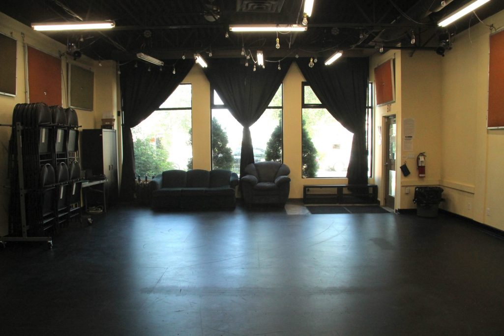 The Playhouse Rehearsal Hall For Rent in Edmonton With Bare Floors and Sunlight Streaming In Through the Large Windows